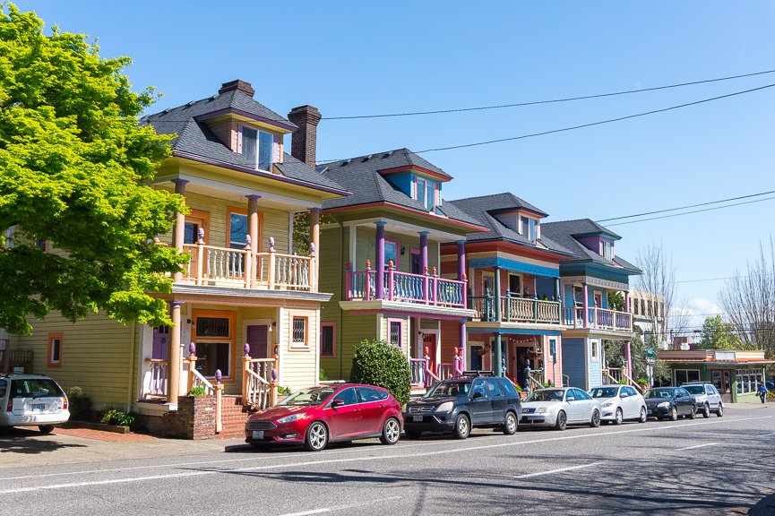 Multi-coloured two-storey houses in Portland Oregon, which just so happens to be one of the best places to travel alone in the US.
