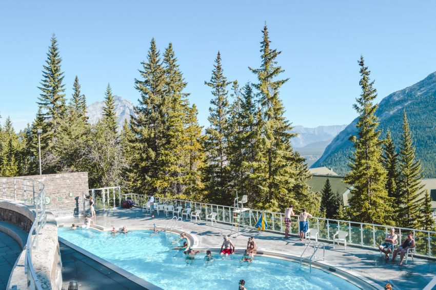 Upper Banff Hot Springs, an outdoor pool surrounded by pine trees.