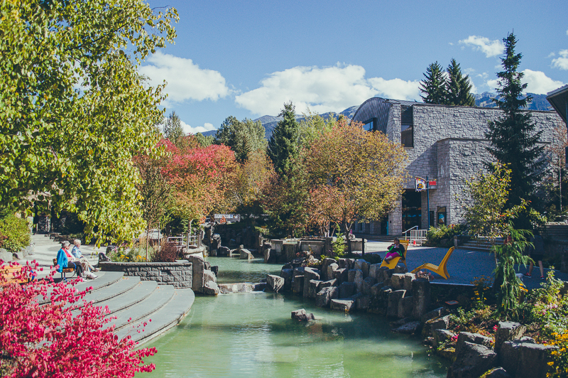 Serene river views and red-leaved trees in Whistler Village (start here on your Whistler day trip).