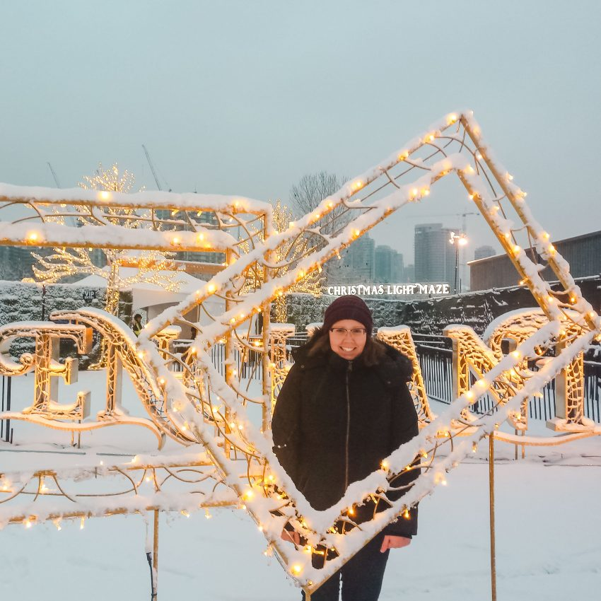 Standing in the snow at Enchant Christmas in Vancouver, Canada