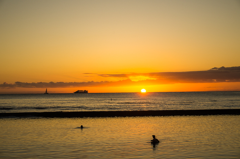 Sunsets over Waikiki Beach in Honolulu, Oahu, Hawaii, one of the best solo travel destinations in the United States.