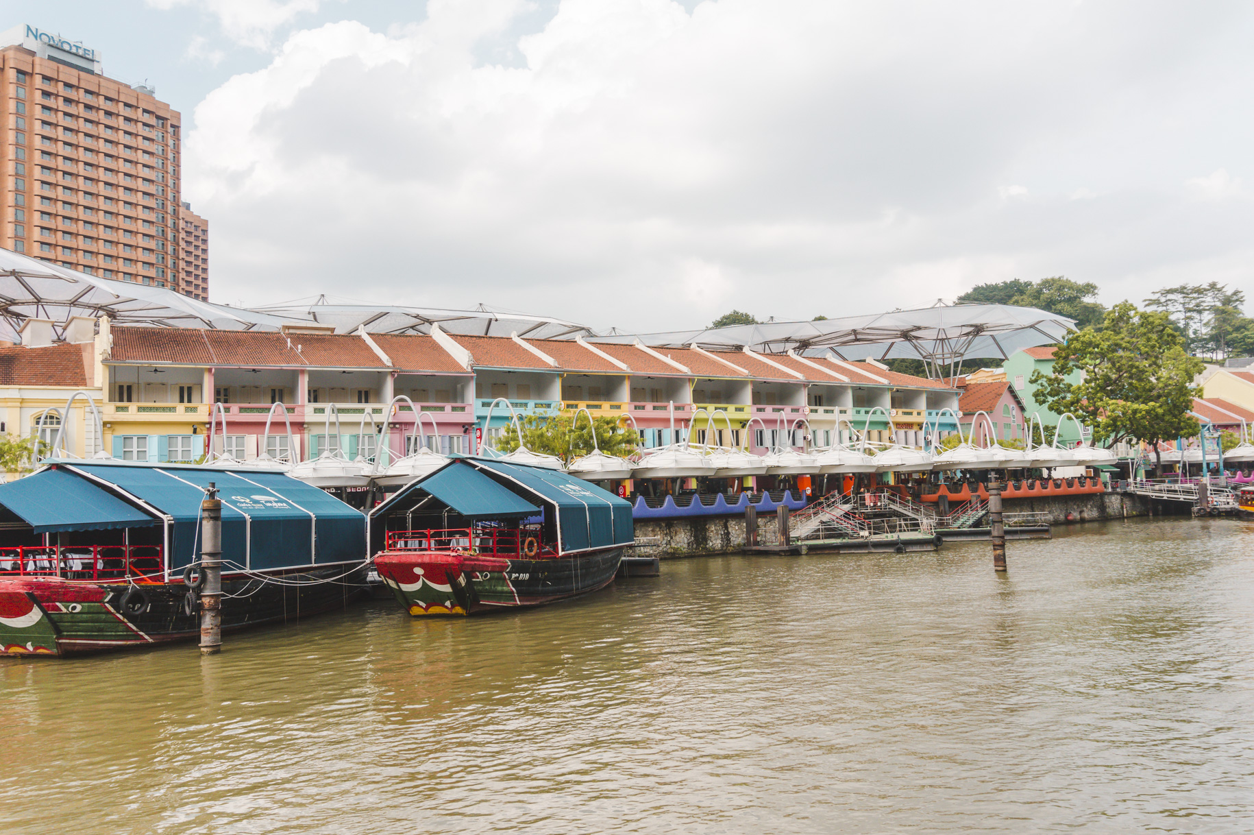The pastel-coloured buildings of Clarke Quay, on the river in Singapore.