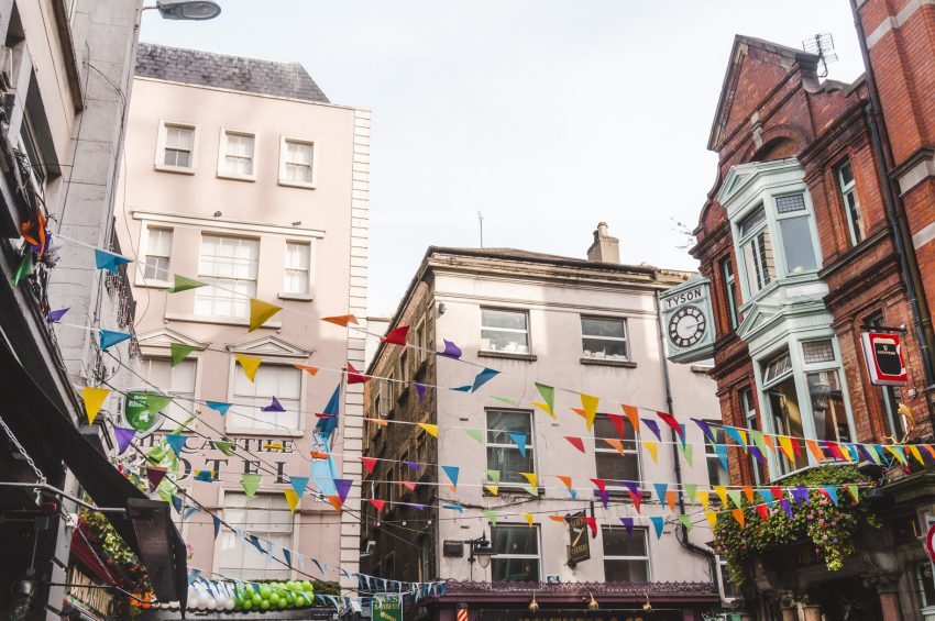 Colourful flags and buildings in Dublin, Ireland - one of the best solo travel destinations.