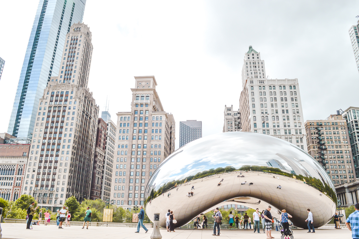 The reflective Bean in Chicago, backdropped by skyscrapers and older office buildings. Chicago is also one of the best places to travel alone in the US.