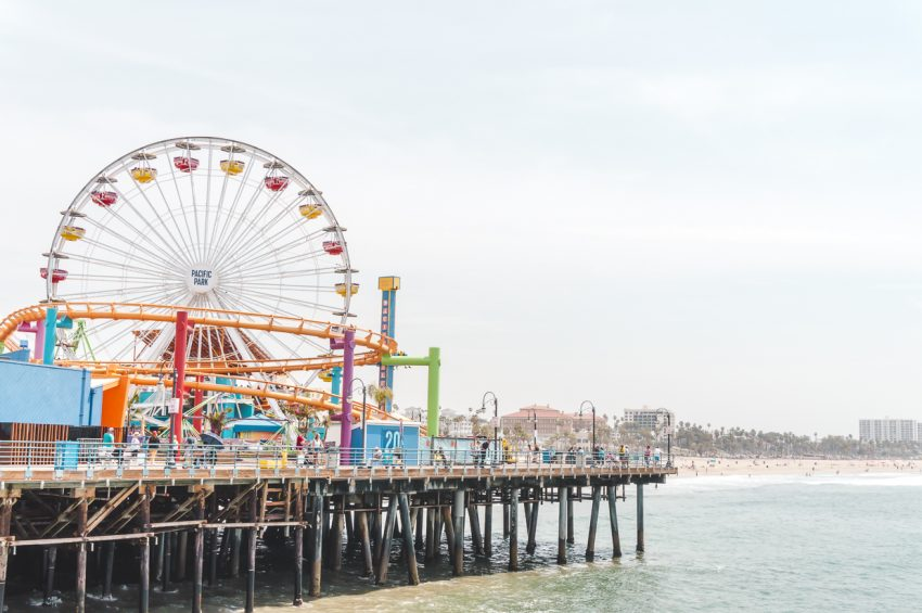 Ferris wheel and roller coaster at Santa Monica Pier in Los Angeles, California (another one of the best places for solo vacations USA).