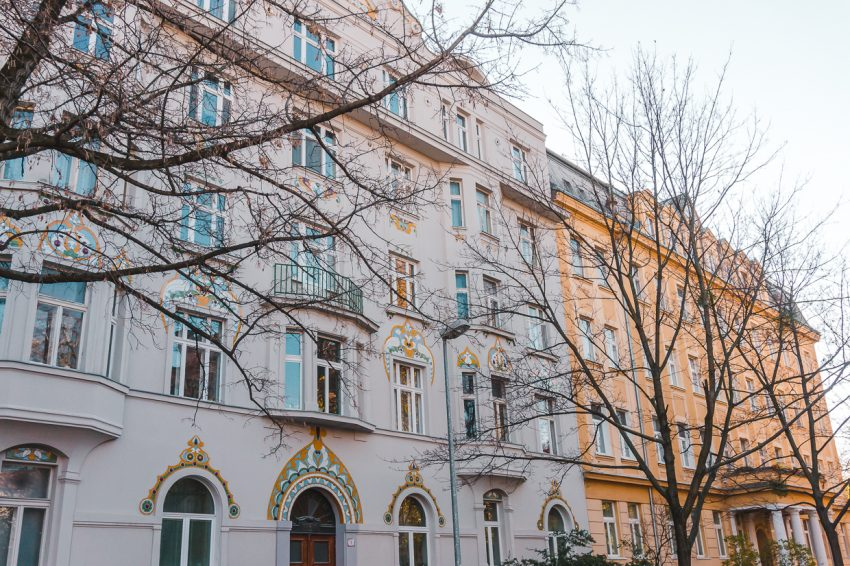 Light pink and mustard-coloured buildings in Bratislava, which I visited on a Bratislava day trip from Vienna.
