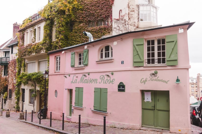 The famous pink La Maison Rose building in Paris, France. Definitely add Paris to your 10-week Europe itinerary.