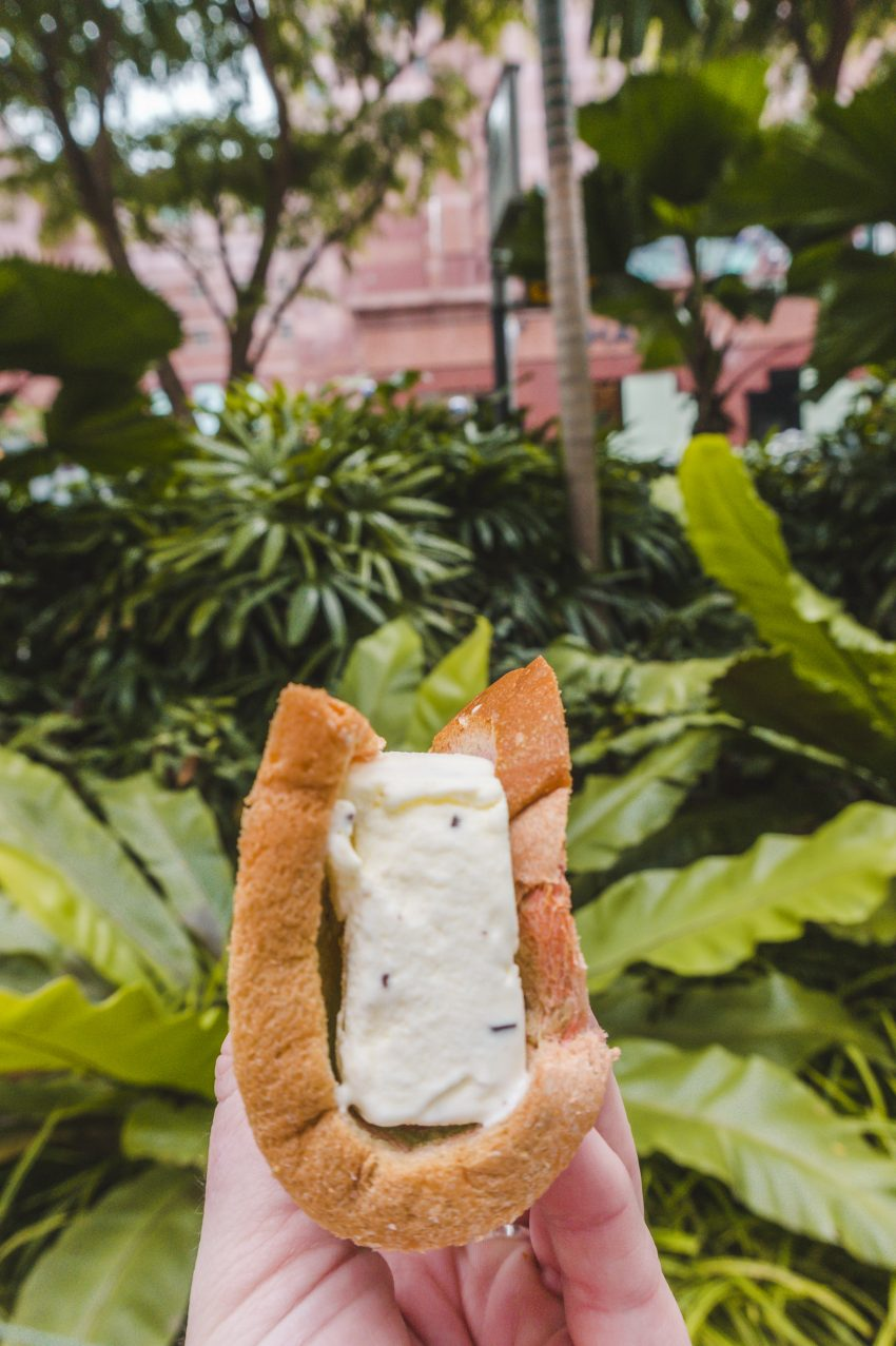 Eating an ice cream sandwich on Orchard Road in Singapore.