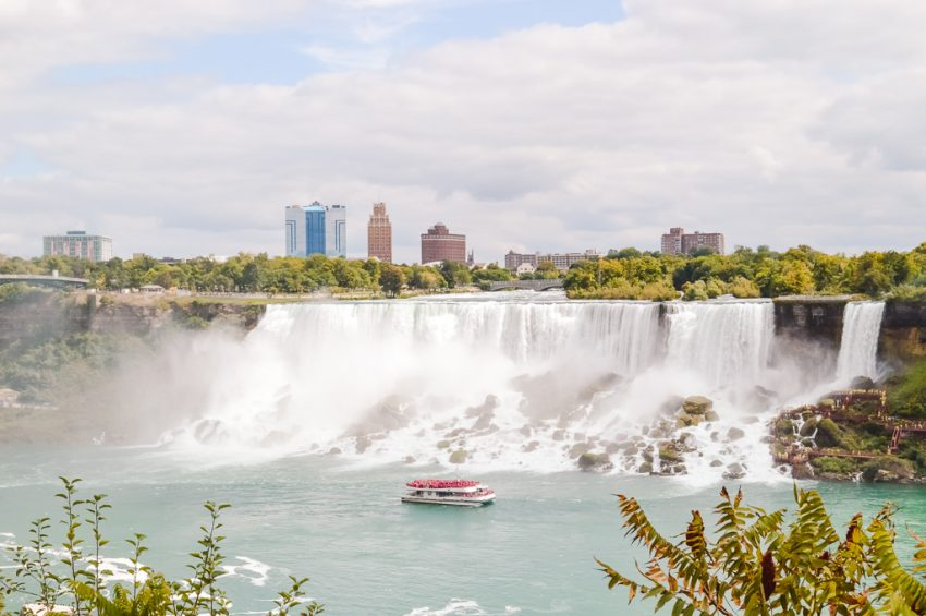 A boat passing by the powerful Horseshoe Falls. Add Niagara Falls to your Canada holiday itinerary and North America itinerary!