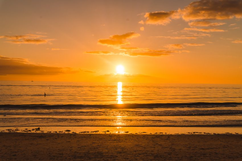Orange glow watching the sunset at Henley Beach in Adelaide. Definitely see a beach sunset during your weekend in Adelaide.