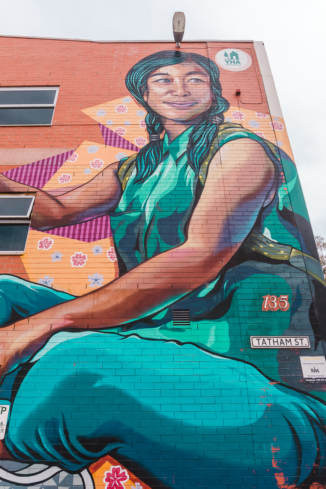 Street art of a woman outside the YHA Adelaide, a budget-friendly accommodation for your weekend in Adelaide.