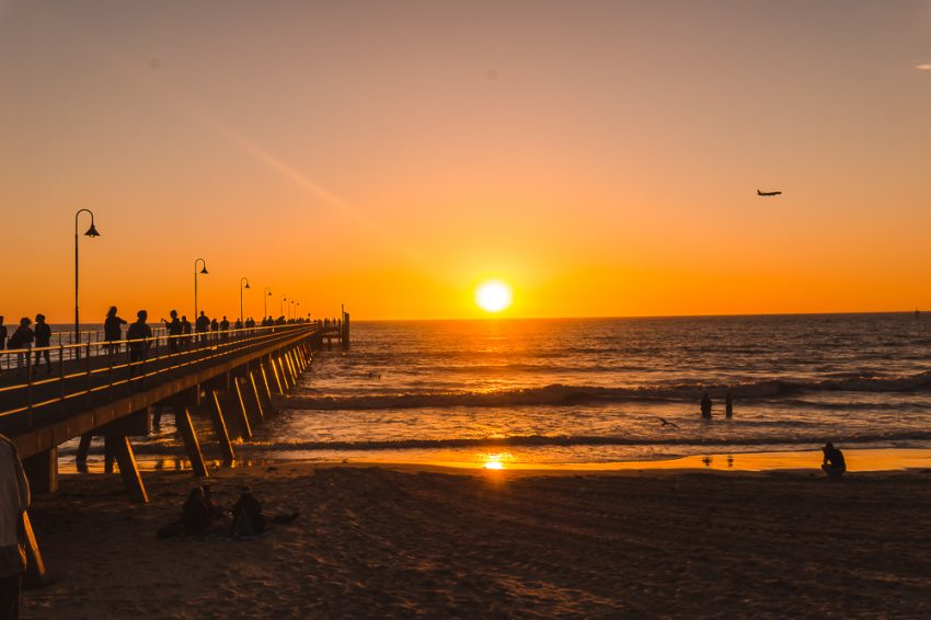 Watching the sunset at Glenelg Beach in Adelaide, South Australia - one of the top solo travel destinations in Australia.