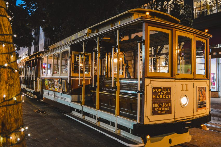 A historic San Francisco cable car at night. San Francisco, California should be on every solo traveller's North America itinerary.