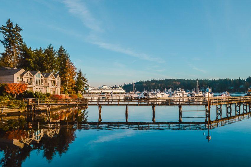 House, bridge and boat reflectings on Bainbridge Island near Seattle, Washington