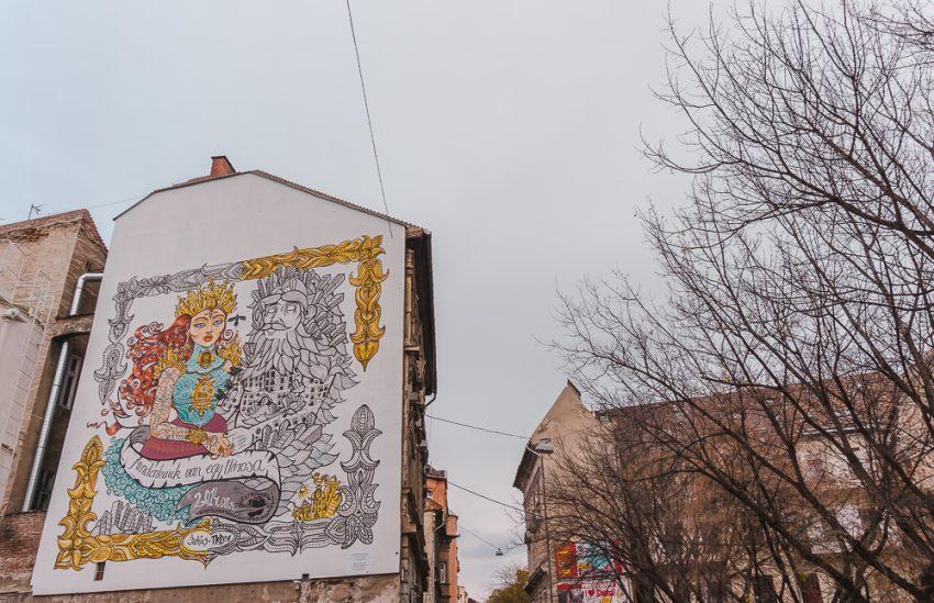 Whimsical Buda versus Pest street art in Budapest's Jewish Quarter.