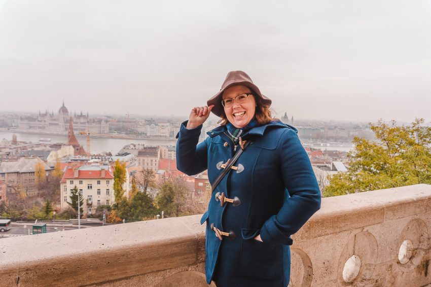 Posing at Fisherman's Bastion in Budapest, Hungary, with the city in the background.