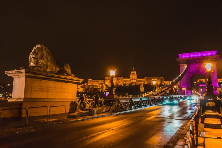 Chain Bridge in Budapest illuminated at night. Photographing the city at night is one of the top things to do in Budapest in winter.