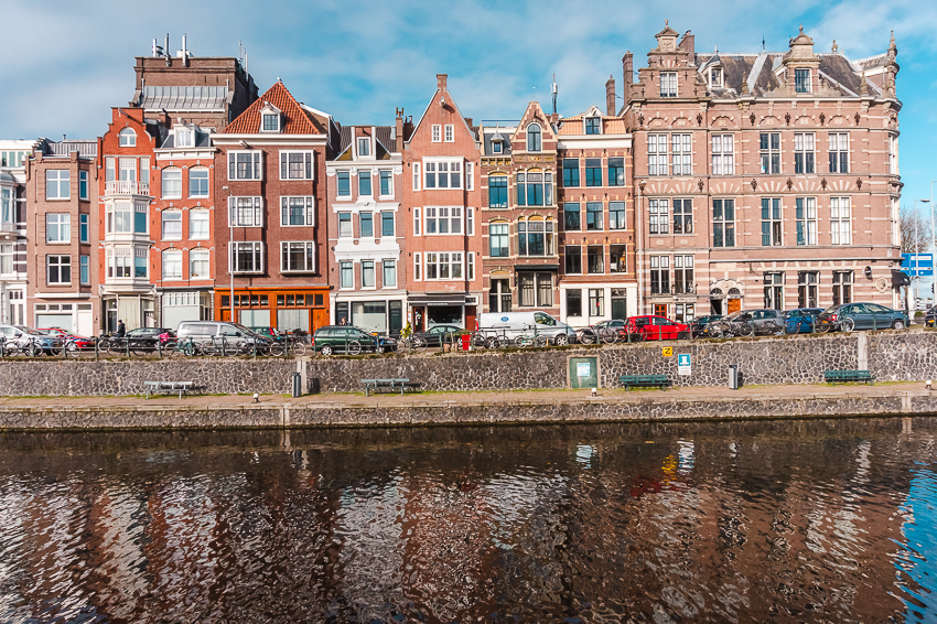 Three Days in Amsterdam: wander the streets to see the unique architecture reflected in the canals.