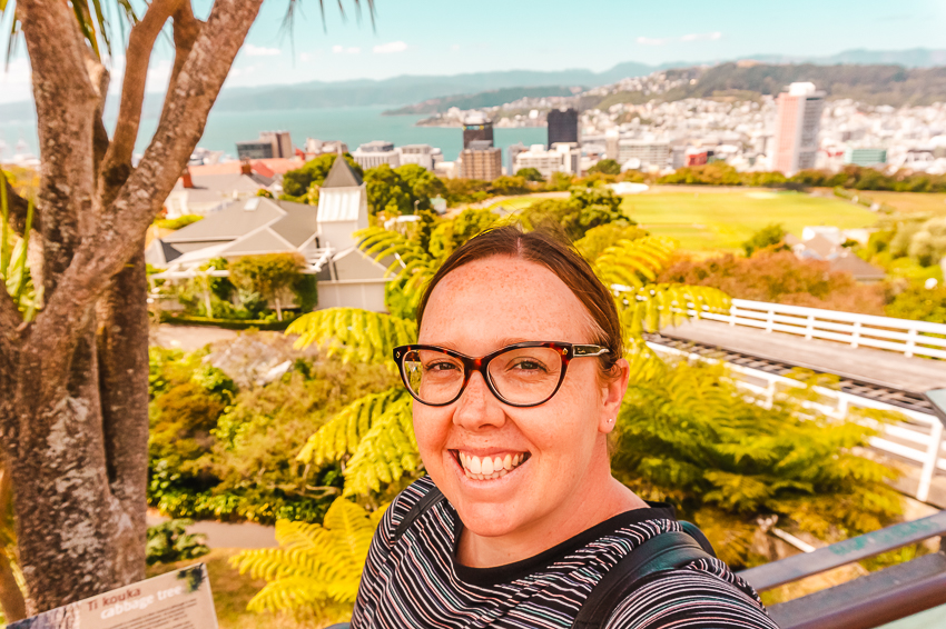 Selfie at Cable Car lookout in Wellington, New Zealand. Welcome to the About page for Australian solo travel blogger and travel content writer, Hayley Simpson.