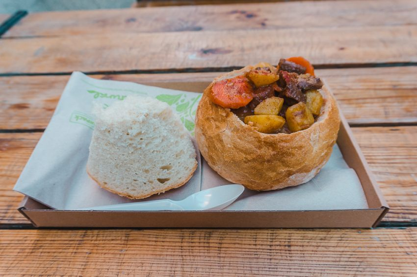 Dont be afraid to dine solo when travelling in Europe alone. Here is a bread bowl overflowing with goulash in Budapest, Hungary.