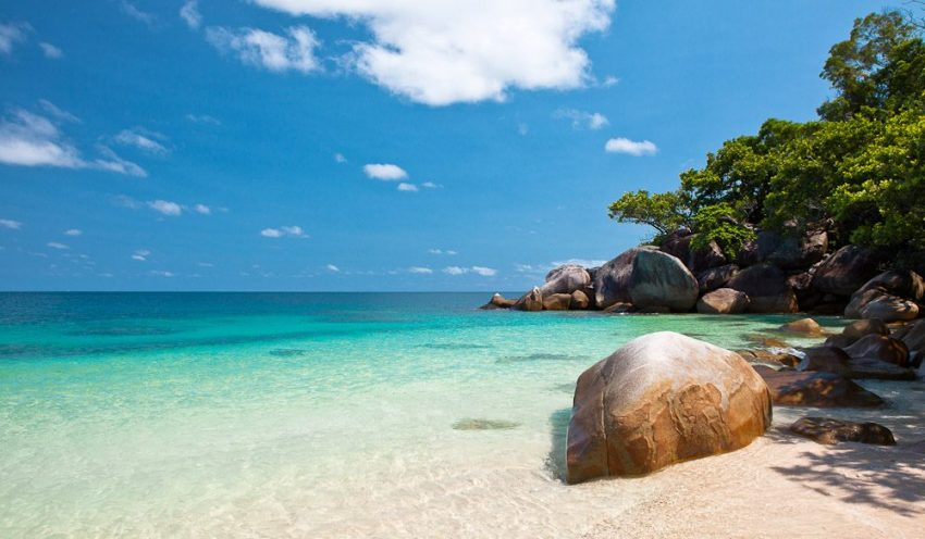 The clear and turquoise waters of Fitzroy Island near Cairns, Queensland, one of the best solo travel destinations in Australia.