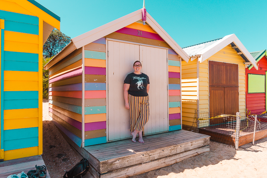 Standing in front of the colourful Brighton Bathing Boxes in Melbourne.