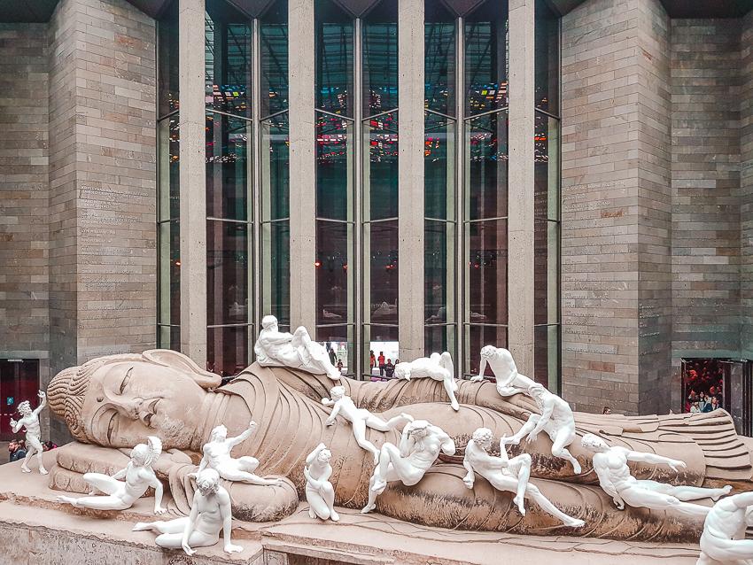 Large horizontal Buddha sculpture at NGV International in Melbourne