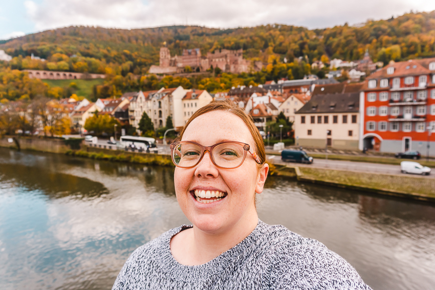 Smiling with the castle backdrop in Heidelberg, Germany