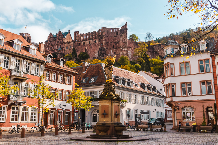 View of colourful buildings and Heidelberg Castle from Kornmarkt in Heidelberg, Germany