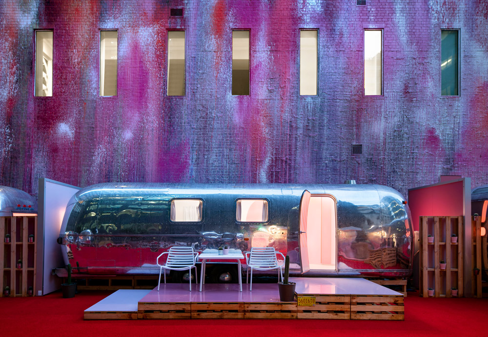 Where to stay in Melbourne - Notel Melbourne. Home to airstreams on a rooftop, with a colourful mural backdrop.