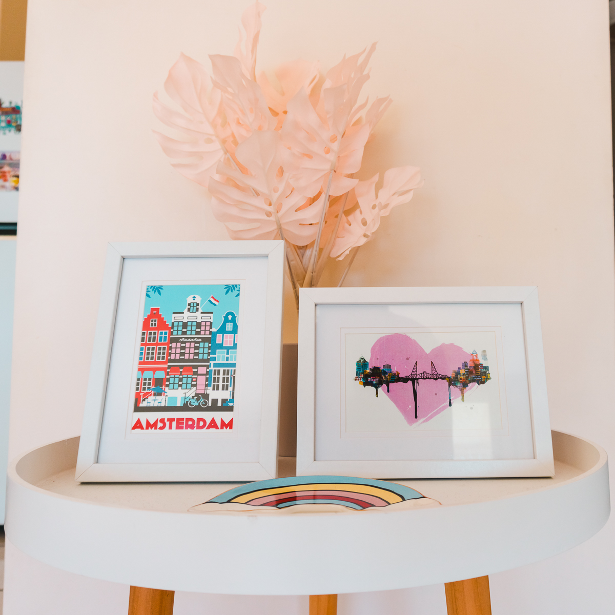 Travel-themed decor ideas - postcards in white photo frames.