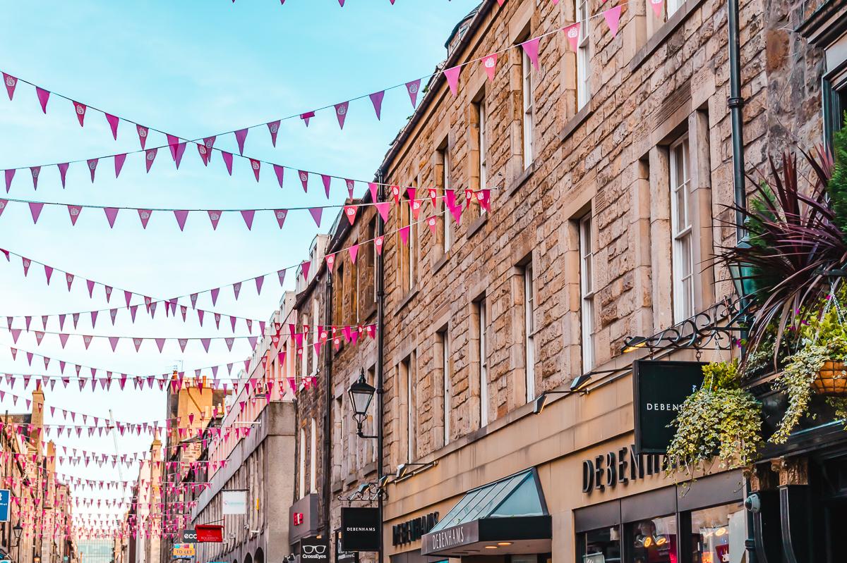 Pink bunting strung between brick buildings in Edinburgh's New Town