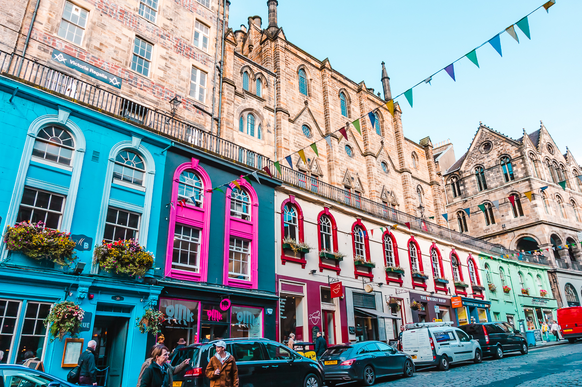 Colourful shop fronts and brick buildings lining Victoria Street in Edinburgh, Scotland