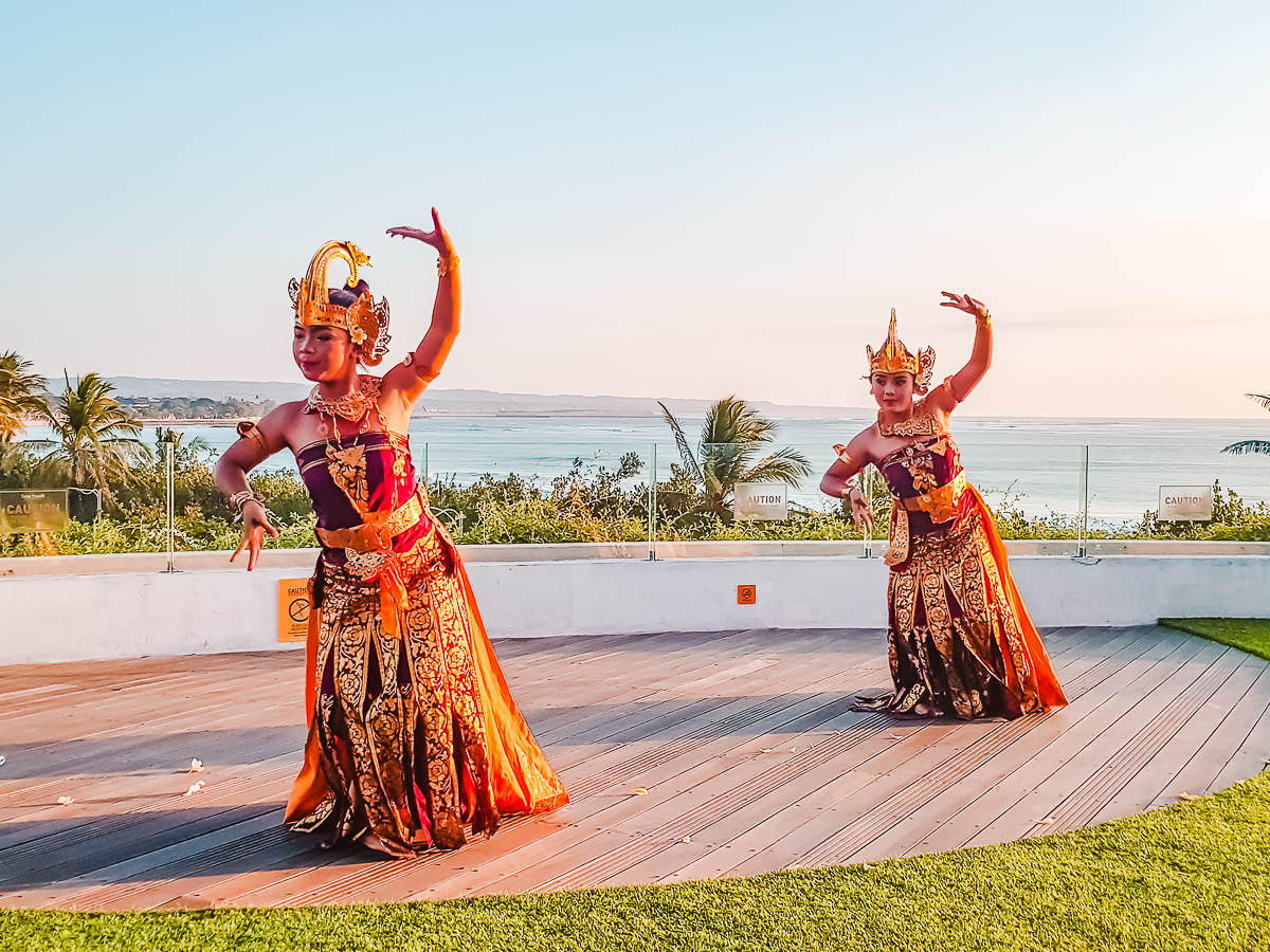 Two dancers in traditional Balinese dress performing on a deck at Beachwalk Shopping Centre in Kuta, Bali