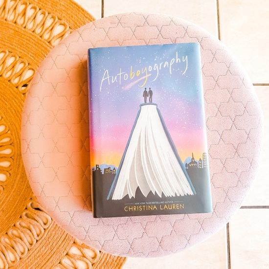 Autoboyography, a novel sitting atop a pink velvet ottoman, which is on a circular jute rug (my favourite books of 2020 so far).