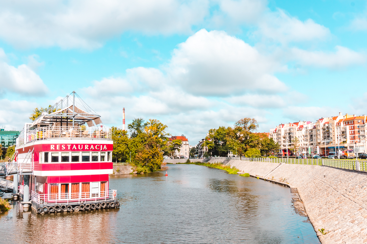A large boat on the Oder River in Wroclaw, Poland. One of the best things to do in Wroclaw is a boat tour in the summer.