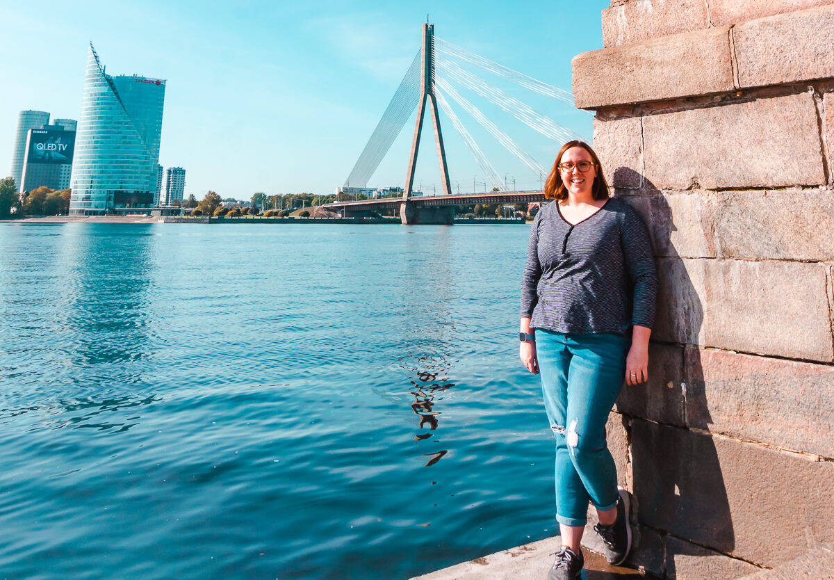 Standing in front of the river in Riga, Latvia